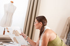 Fashion designer working at studio Royalty Free Stock Photography