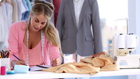 Fashion designer working stock footage