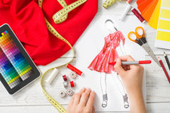 Fashion designer. Working in studio. Close up design Royalty Free Stock Images