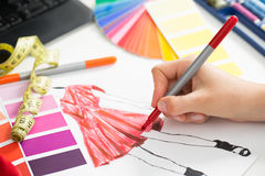 Fashion designer. Working in studio. Close up design Royalty Free Stock Photo