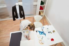 Fashion designer working in studio Royalty Free Stock Image