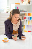 Fashion designer working on tablet pc Royalty Free Stock Image