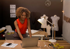 Fashion designer. A young fashion designer working on her atelier Royalty Free Stock Images