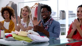 Fashion designers applauding together stock footage