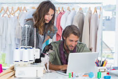 Fashion designers with chihuahua working Royalty Free Stock Photography