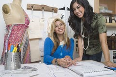 Fashion Designers At Desk Royalty Free Stock Images