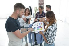 Fashion designers discussing color palette in the Studio. Photo with copy space stock photography