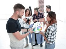 Fashion designers discussing color palette in the Studio. Photo with copy space stock image