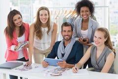 Fashion designers discussing designs Stock Photos
