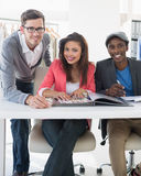 Fashion designers discussing designs Stock Images