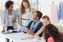 Fashion designers discussing designs Stock Photo