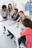 Fashion designers discussing designs Royalty Free Stock Photo