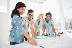 Fashion designers discussing designs Stock Image