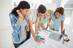 Fashion designers discussing designs Stock Photography