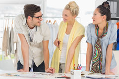Fashion designers discussing designs Royalty Free Stock Photography
