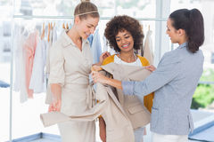 Fashion designers looking at a blazer. In a studio royalty free stock image