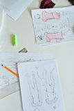 Fashion Designers Sketches on Working Table Stock Photo