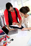 Fashion designers at work Stock Images