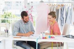 Fashion designers at work in bright studio Stock Photos