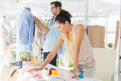 Fashion designers at work in bright studio Stock Image