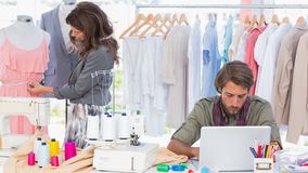 Fashion designers working in a bright office Royalty Free Stock Photography