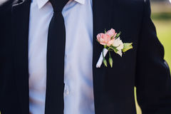 Fashion detail image of a groom wearing. A bowtie on his wedding day Stock Photo