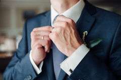 Fashion detail image of a groom wearing. A bowtie on his wedding day Stock Images