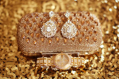 Fashion diamond earrings and golden wristwatch, womens accessori Stock Images