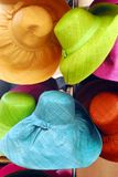 FASHION- Display of Colorful Sun Hats in France stock photos