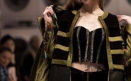 Fashion dress Model walk back dark Runway Fashion. Fashion dress Model walk back on dark Runway Fashion Show catwalk with lighting along way finale, background stock photography
