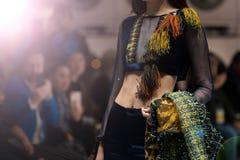 Fashion dress Model walk back dark Runway Fashion. Fashion dress Model walk back on dark Runway Fashion Show catwalk with lighting along way finale, background royalty free stock photos