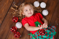 Fashion dressed girl lady with crown close to christmas tree with presents Royalty Free Stock Photos