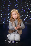 Fashion dressed girl lady with crown close to christmas tree with presents Royalty Free Stock Photo