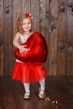 Fashion dressed girl lady with crown close to christmas tree with presents Royalty Free Stock Images