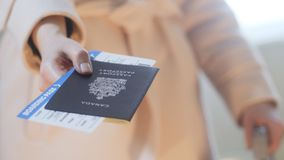 Girl holds Canadian passport and boarding pass Stock Photos