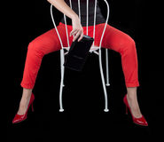 Fashion Dressed Sexy Girl Sitting on Chair. Stock Images