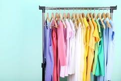 Fashion dresses. Hanging on mint background stock photo