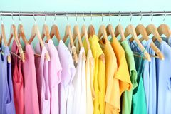 Fashion dresses. Hanging on mint background stock images
