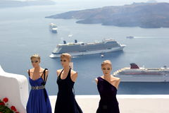 Fashion dummies. Trio of female fashion dummies in Santorini (Greece) with big cruising ships in the background royalty free stock images