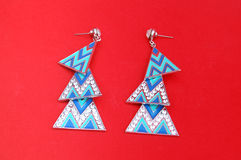 Fashion earings on red background Royalty Free Stock Photography