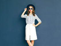 Fashion elegant lady woman wearing a black sunglasses, hat and white skirt Stock Images