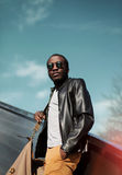 Fashion elegant young african man wearing a black leather jacket Stock Image