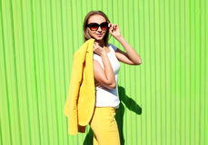 Fashion elegant young woman in yellow suit clothes Stock Photos