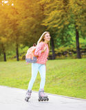 Fashion, extreme, vacation and people concept - pretty sporty girl Stock Images