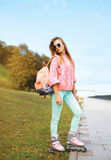 Fashion, extreme, youth and people concept - pretty stylish girl Stock Images