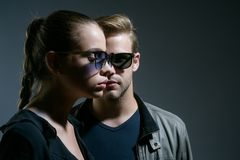 Fashion eyewear. Friendship day. Friendship relations. Fashion models in trendy sun glasses. Couple in love. Couple of. Men and women wear fashion glasses. Love royalty free stock image