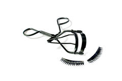Fashion fake false eyelash and eyelash curler isolated. On white background Royalty Free Stock Photos