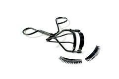 Fashion fake false eyelash and eyelash curler isolated Royalty Free Stock Photos
