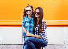 Fashion family concept - stylish mother and child Royalty Free Stock Photos