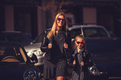 Fashion family. woman with child girl in family fashionable look Royalty Free Stock Photos